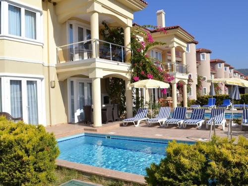 book Fethiye Sunset Beach Club Oyster Villa 1