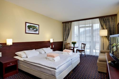 Standartinis dvivietis numeris su balkonu (Standard Double Room with Balcony)