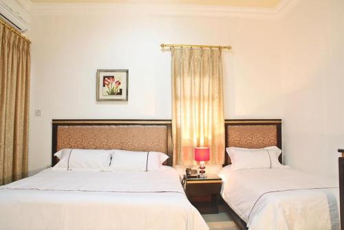 Golden Rose Hotel istabas fotogrāfijas