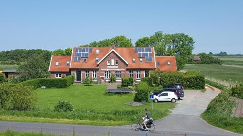 Hotel-overnachting met je hond in Ferienwohnungen Zollhaus Utlandshoern - Norden