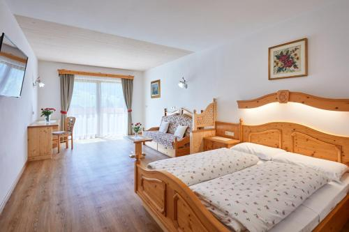 Double Room (2 Adults + 1 Child) with Balcony