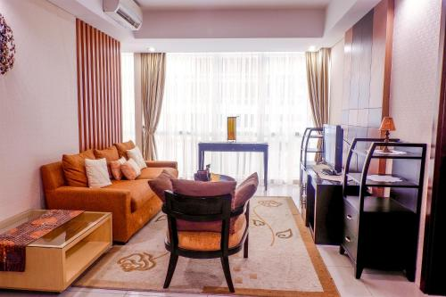. 2BR Cozy Pool View Kemang Village Residence Apartment By Travelio
