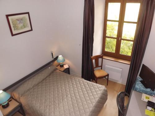 Fotos de quarto de Logis Hostellerie des Lauriers
