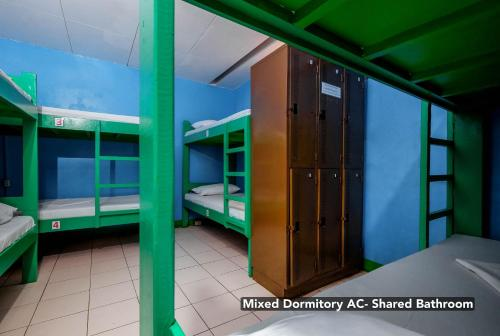 Mixed Dormitory Aircon Room with Shared Bathroom