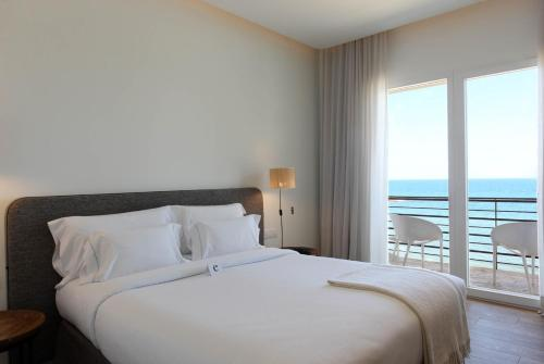 Doppelzimmer mit Meerblick und Balkon Hostal Spa Empúries 10