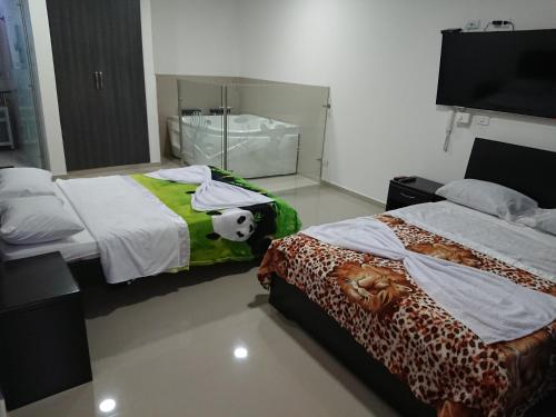 Bilik Deluxe Queen dengan 2 Katil Queen (Deluxe Queen Room with Two Queen Beds)