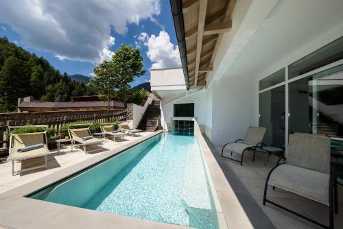 Aparthotel Wellness Villa di Bosco - Hotel - Alpe di Pampeago