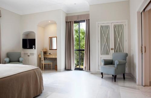 Suite Junior con vistas al jardín  Villa Jerez 11