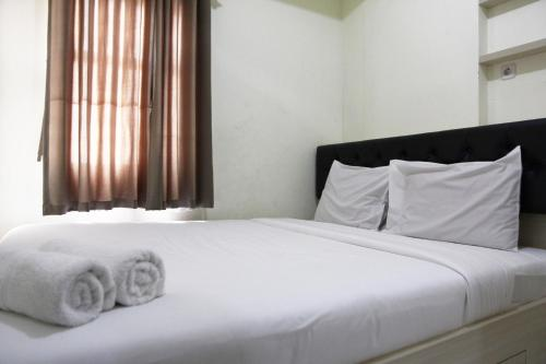 . Pool View 2BR Kemang View Apartment By Travelio