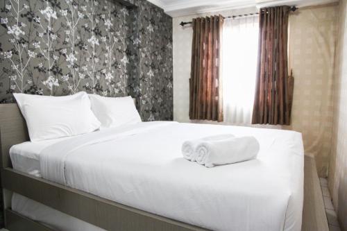 . Homey 1BR @ Mutiara Bekasi Apartment By Travelio