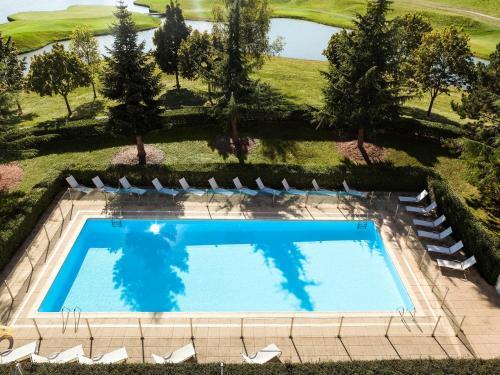 Novotel Saint Quentin Golf National,  1 Avenue du Golf, 78114 Magny Les Hameaux, France.