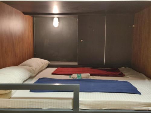 Queen bed pod with shared bathroom