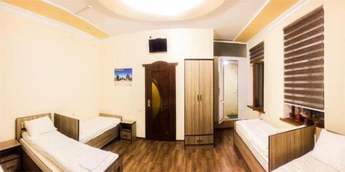 Giường trong Phòng ngủ tập thể 4 người (Bed in 4-Bed Dormitory Room)