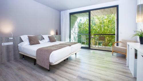 Habitación Doble Superior con balcón URH - Hotel Molí del Mig 15