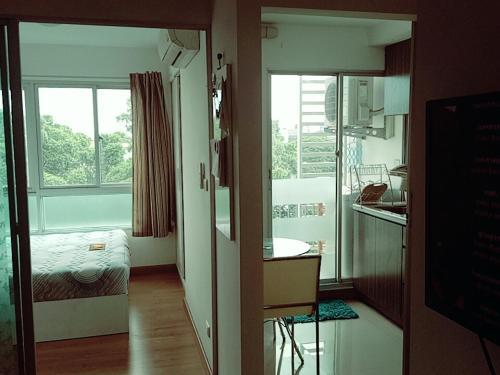 4-164 Den Condominium