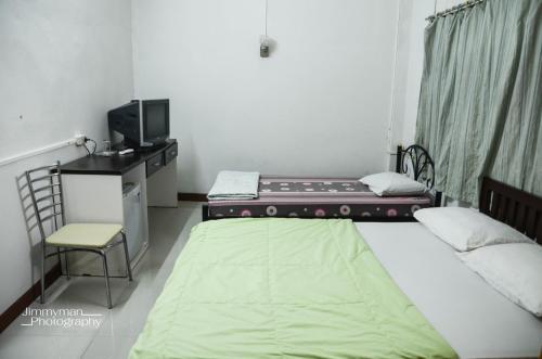 Chinawat Hotel istabas fotogrāfijas