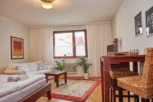 Wohnen im Kolonialstil inklusive Tiefgarage, kontaktloser Check-in, Pension in Klagenfurt