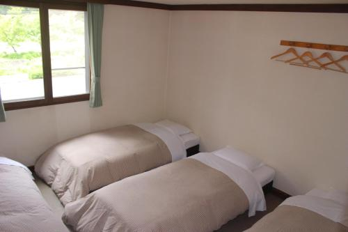 四人房-附共用衛浴 (Quadruple Room with Shared Bathroom)