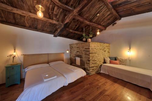 Habitación Doble Deluxe - 2 camas - Uso individual Casa Rural Piñeiro, de Vila Sen Vento 1