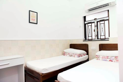 Ah Shan Hostel istabas fotogrāfijas