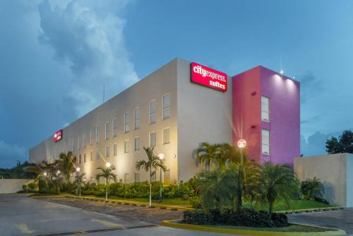 Фото отеля City Express Suites Playa del Carmen