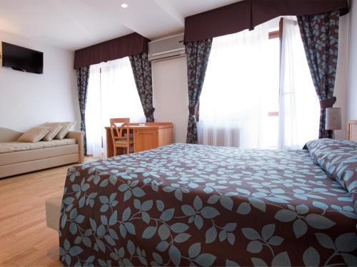 Hotel Angelo istabas fotogrāfijas