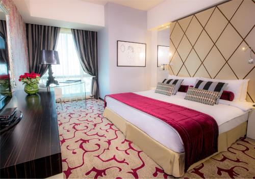 Grand Millennium Hotel Amman room photos