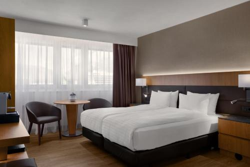 Standard Guest Room with Two Double Beds and Mountain View