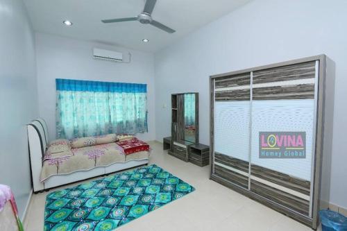 Rumah Tamu Lovina Arau - Photo 3 of 10