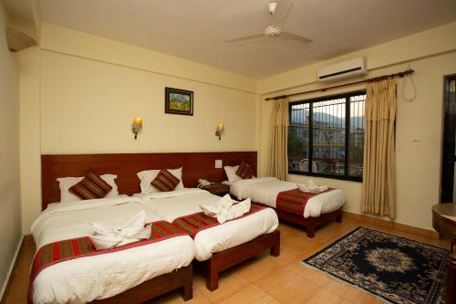 Deluxe Triple Room with Balcony Exclusive and In-house Discounts
