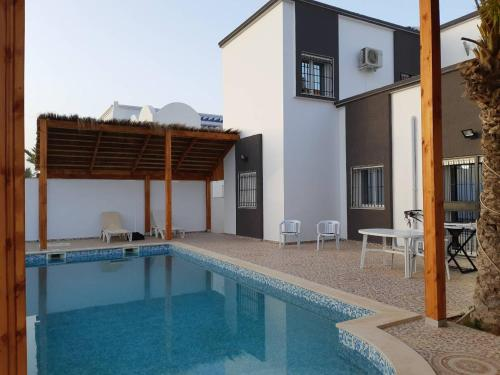 Villa de charme midoun фото номерів