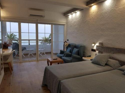 Double Room with Sea View (2 Adults + 1 Child)