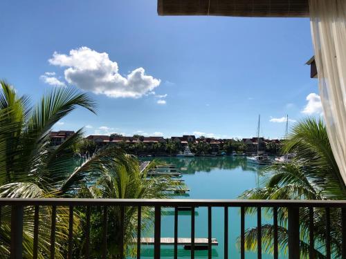 . Eden Island Marina apt. with a jet ski, BBQ grill, WiFi, Sat TV and pool