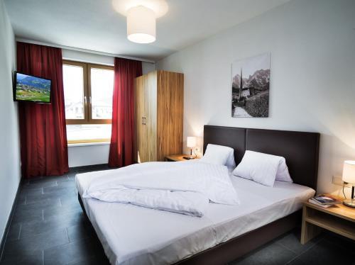 Фото отеля AlpenParks Residence Zell am See