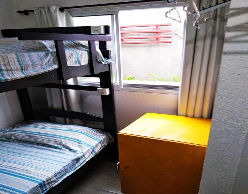 Bed in 4-Bed Male Dormitory Room with Private Bathroom