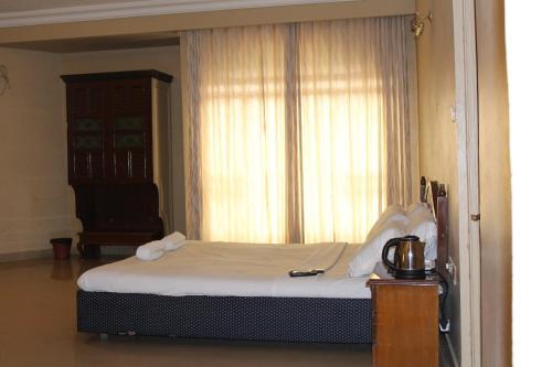 Hotel Pooja International værelse billeder