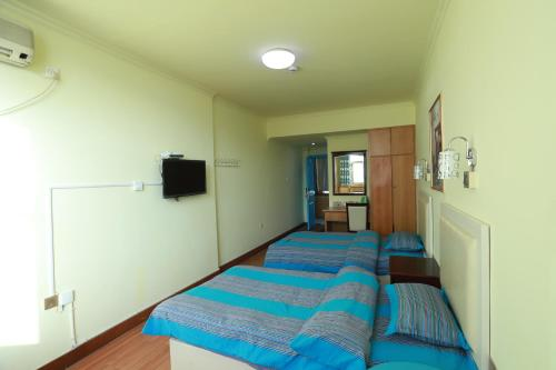 Kamar Twin dengan Shower (Twin Room with Shower)