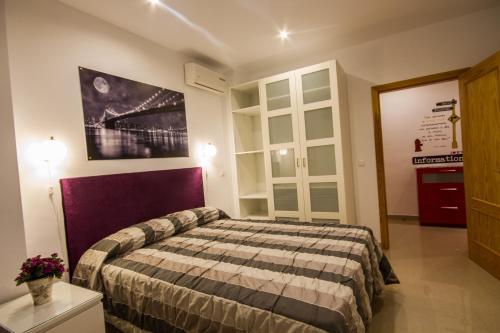 . Apartamentos El Templo Suites