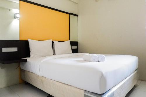 . Pool View 2BR at Dian Regency Apartment By Travelio