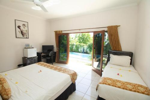 Quarto Duplo Deluxe com Varanda e Vista Mar (Deluxe Double Room with Balcony and Sea View)