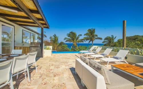 . Villa Topaz Above West Bay with 360 Degree Views! 4 Bedroom Option