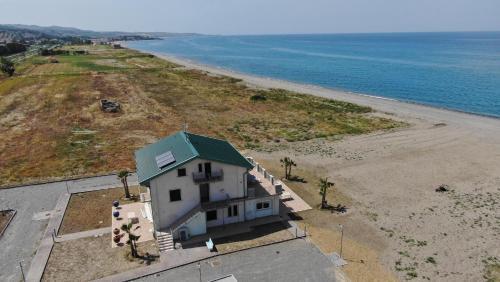 . Green House Beach