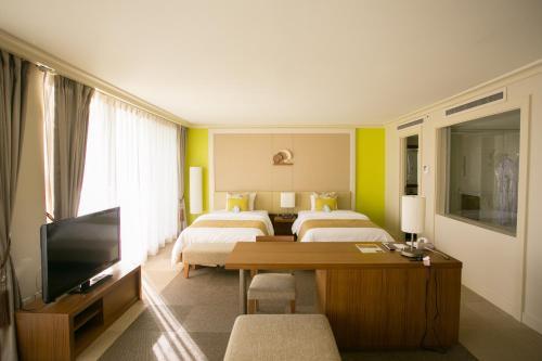 Guam Reef Hotel istabas fotogrāfijas