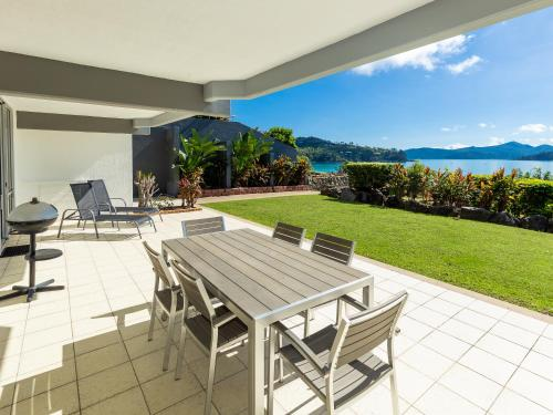 . Frangipani Beachfront Lodge F5 on Hamilton Island by HamoRent