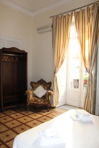 Фото отеля Aloi Rooms