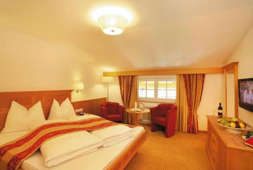 Фото отеля Alpenherz Hotel Garni