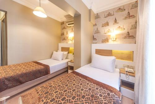 Kamar Economy Double atau Twin (Economy Double or Twin Room)