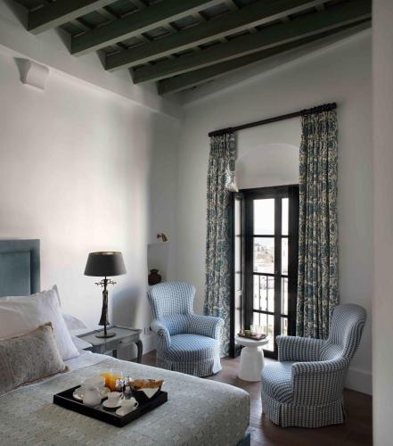 Habitación Deluxe con cama extragrande - Uso individual Hotel La Casa del Califa 1