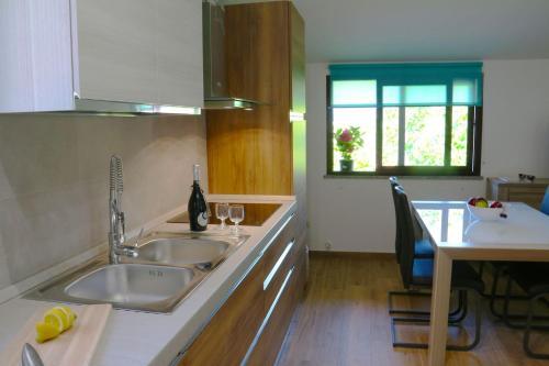 Casa Vacanze il Giardino - Appartamento Agrifoglio img9