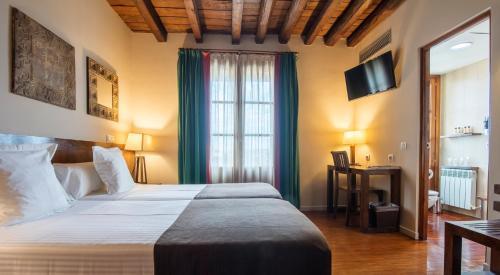 Habitación Doble con cama supletoria  Abad Toledo 2